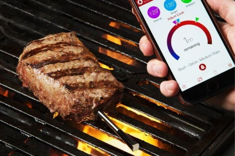 A meat thermometer in use